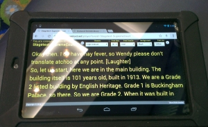 Live captions on a tablet.