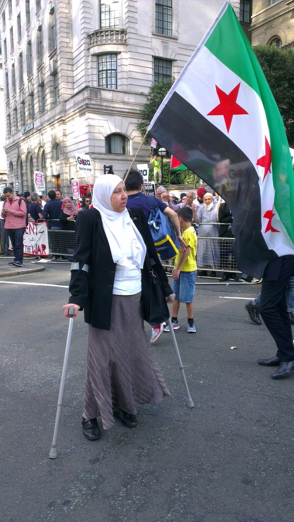 A woman who braved her pain just to be a part of the protest. Photo by SJ.